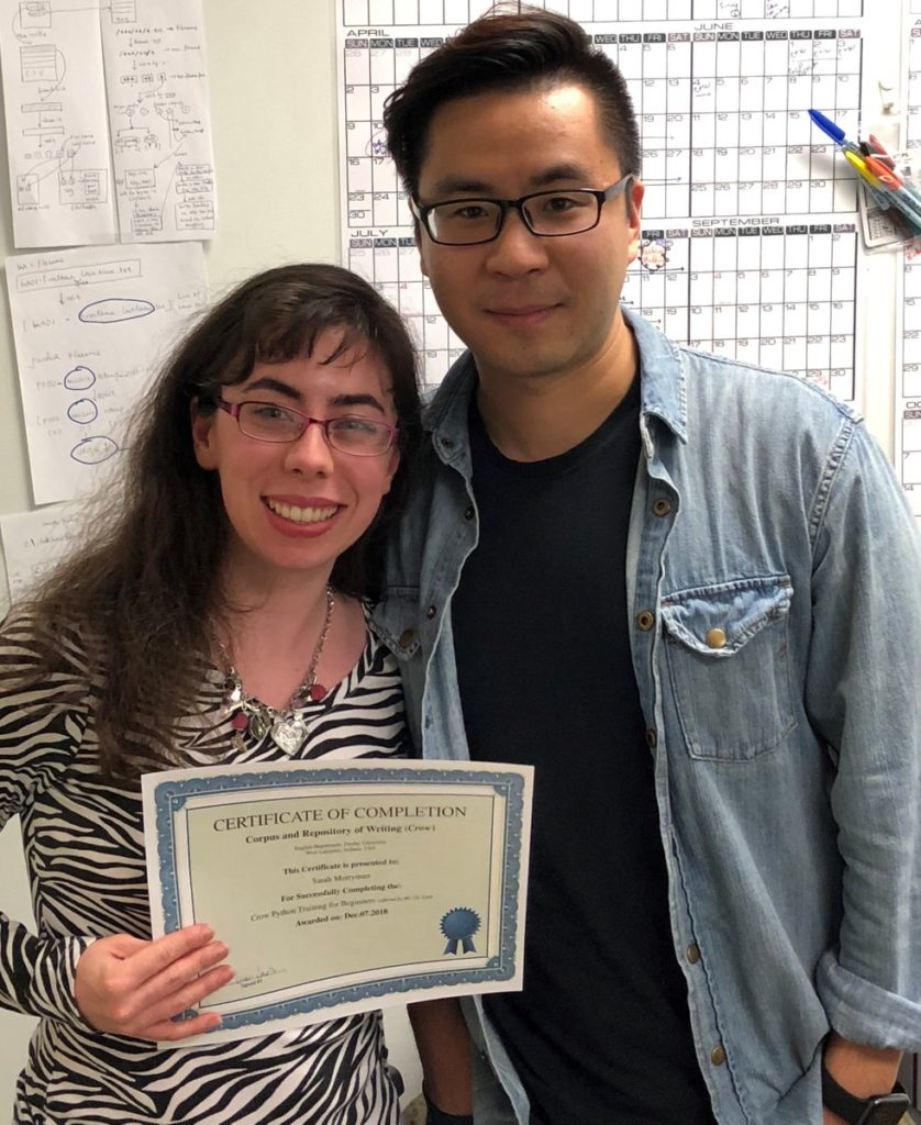 Sarah proudly displays her certificate for completing the introductory Python coding course with teacher, and fellow Crowbird Ge Lan.
