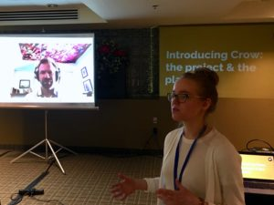 Emily Jones introduces the Crow platform, with Mark Fullmer in the background via videoconference.